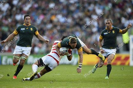 Jean De Villiers of South Africa is tackled