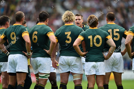 South Africa captain Jean De Villiers speaks to his players during a break in play