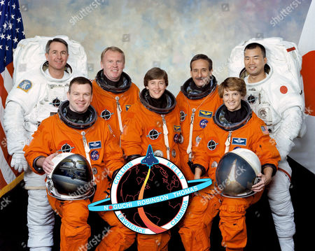 The STS-114 crew. In front are astronauts Eileen M. Collins (right), commander; Wendy B. Lawrence, mission specialist; and James M. Kelly, pilot. In back are astronauts Stephen K. Robinson (left), Andrew S. W. Thomas, Charles J. Camarda, and Soichi Noguchi, all mission specialists. Noguchi represents Japan Aerospace Exploration Agency (JAXA).