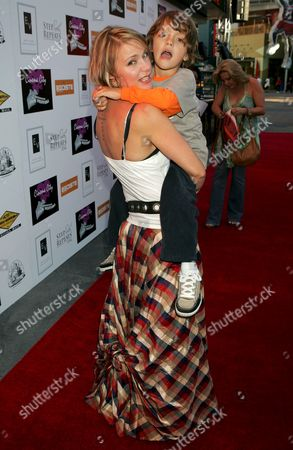 Stock Picture of Dedee Pfeiffer, son Baxter (note tattoo on back)