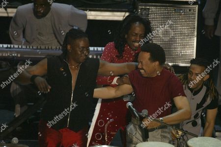 Stock Picture of Philip Bailey (L), Veredine White (C) and Maurice White  of Earth, Wind & Fire perfrom during the 2nd Annual BET Awards in Hollywood, California on June 25, 2002.   Photo by: Adrees Latif Photo® Adrees Latif / BEImages.net
