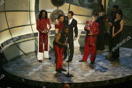 Stock Image of Philip Bailey of Earth, Wind & Fire accepts the Lifetime Achievement Award as group members (L to R) Verdine White, Maurice White,  Larry Dunn and Al McKay look on during the 2nd Annual BET Awards in Hollywood, California on June 25, 2002.   Photo by: Adrees Latif Photo® Adrees Latif / BEImages.net