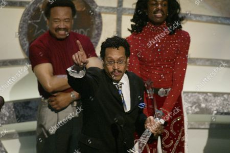 Larry Dunn (C) of Earth, Wind & Fire accepts the Lifetime Achievement Award as group members (L to R)  Maurice White and Verdine White look on during the 2nd Annual BET Awards in Hollywood, California on June 25, 2002.  Photo by: Adrees Latif Photo® Adrees Latif / BEImages.net