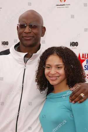 Stock Image of Eric Dickerson and daughter Erica Dickerson