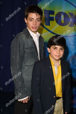 """Andy Lawrence (left) and Grant Rosenmeyer (""""Oliver Beene"""") at the FOX Televison Network 2002-2003 Upfront Presentation after-party at Pier 88 in New York City on May 16, 2002.  Manhattan, New York  Photo® Matt Baron/BEI"""
