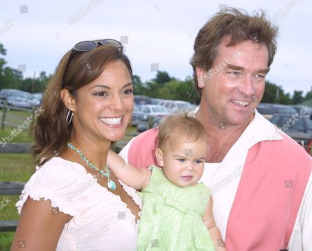 "Eva La Rue (left) and husband John Callahan with baby daughter  at the 5th Annual ""Super Saturday"", a star studded designer sale and family event to benefit the Ovarian Cancer Research Fund, at Nova's Art Project in Watermill, NY on July 27, 2002.