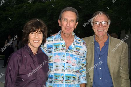 """Nora Ephron (left), Arne Glimcher and Nick Pileggi at a party to celebrate the African Enviromental Film Foundation's latest film """"Wanted Dead or Alive"""" at the home of producer Arne Glimcher in East Hampton, New York on July 13, 2002.  East Hampton, New York  Photo® Matt Baron/BEImages.net"""