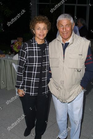 """Don Hewitt and wife at a party to celebrate the African Enviromental Film Foundation's latest film """"Wanted Dead or Alive"""" at the home of producer Arne Glimcher in East Hampton, New York on July 13, 2002.  East Hampton, New York  Photo® Matt Baron/BEImages.net"""
