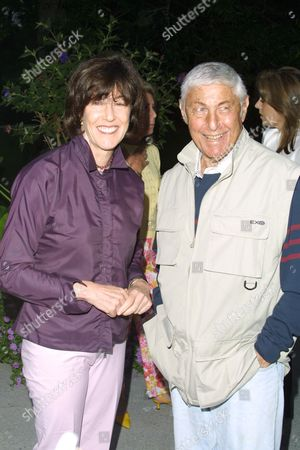 """Director Nora Ephron (left) and Don Hewitt at a party to celebrate the African Enviromental Film Foundation's latest film """"Wanted Dead or Alive"""" at the home of producer Arne Glimcher in East Hampton, New York on July 13, 2002.  East Hampton, New York  Photo® Matt Baron/BEImages.net"""