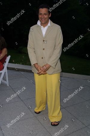 """Isaac Mizrahi at a party to celebrate the African Enviromental Film Foundation's latest film """"Wanted Dead or Alive"""" at the home of producer Arne Glimcher in East Hampton, New York on July 13, 2002.  East Hampton, New York  Photo® Matt Baron/BEImages.net"""