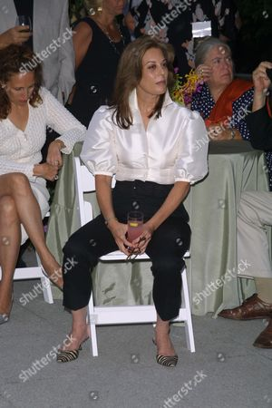 """New York publicist Peggy Siegal at a party to celebrate the African Enviromental Film Foundation's latest film """"Wanted Dead or Alive"""" at the home of producer Arne Glimcher in East Hampton, New York on July 13, 2002.  East Hampton, New York  Photo® Matt Baron/BEImages.net"""