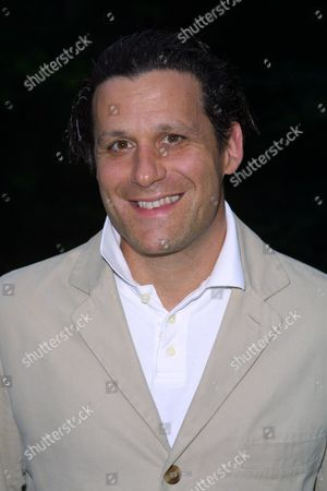 """Stock Picture of Isaac Mizrahi at a party to celebrate the African Enviromental Film Foundation's latest film """"Wanted Dead or Alive"""" at the home of producer Arne Glimcher in East Hampton, New York on July 13, 2002.  East Hampton, New York  Photo® Matt Baron/BEImages.net"""