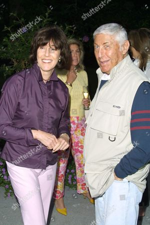 """Stock Photo of Director Nora Ephron (left) and Don Hewitt at a party to celebrate the African Enviromental Film Foundation's latest film """"Wanted Dead or Alive"""" at the home of producer Arne Glimcher in East Hampton, New York on July 13, 2002.  East Hampton, New York  Photo® Matt Baron/BEImages.net"""