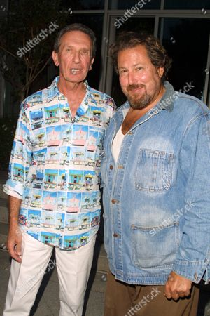"""Producer Arne Glimcher (left) and artist/director Julian Schnabel at a party to celebrate the African Enviromental Film Foundation's latest film """"Wanted Dead or Alive"""" at the home of producer Arne Glimcher in East Hampton, New York on July 13, 2002.  East Hampton, New York  Photo® Matt Baron/BEImages.net"""