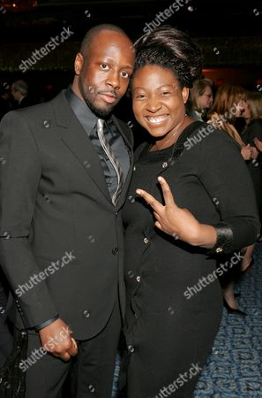 Stock Photo of Wyclef Jean, Suzanne Africa Engo