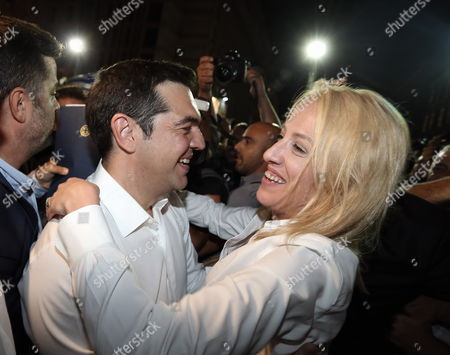 Syriza leader Alexis Tsipras celebrating his party's win with one of his MPs, Rena Dourou