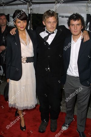 """(From left) Helena Christiansen, Norman Reedus and Balthazar Getty arriving to the premiere of United Artists' """"Deuces Wild"""" at the Clearview Chelsea West Cinemas in New York City on April 22, 2002.  Manhattan, New York  Photo® Matt Baron/BEI"""