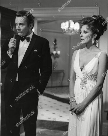 Denholm Elliott and Joan Collins