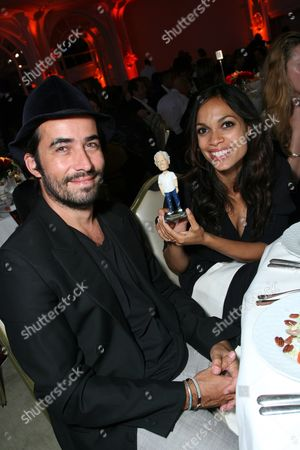 Stock Picture of Mathieu Schreyer and Rosario Dawson