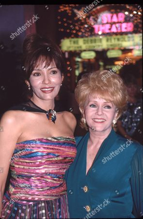 Barbara Carrera and Debbie Reynolds