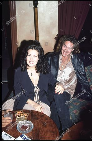 Stock Photo of Sherilyn Fenn and  G. Toulouse Holliday