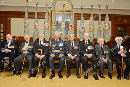 Prince Charles joins Battle of Britain veterans Richard Summers, Tony Pickering, Geoffrey Wellum, Paul Farnes, Tom Neil, Terry Clark, and Ken Wilkinson during a reception at Church House