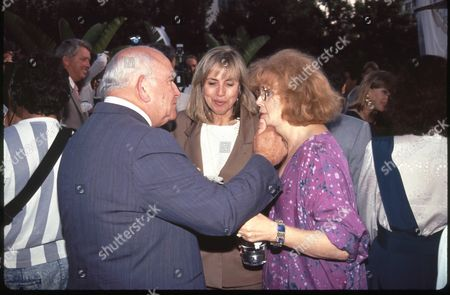 Ed Asner and Eileen Brennan