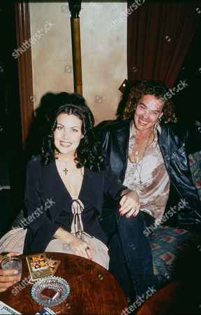 Sherilyn Fenn and G. Toulouse Holliday