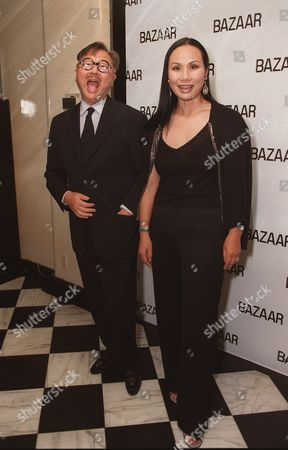 """20000621  Beverly Hills, CA Michael and Eva Chow at the Harper's BAZAAR """"Who's Who in July"""" party and dinner hosted by Harper's BAZAAR Editor-in-Chief Kate Betts and held at Mr. Chow's. Photo®Alex Berliner/BEI      A006190-17a"""