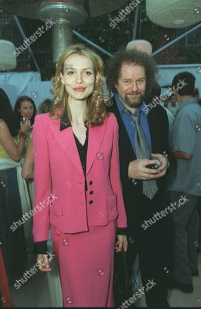 """20000621  Beverly Hills, CA Saffron Burrows and Mike Figgis at the Harper's BAZAAR """"Who's Who in July"""" party and dinner hosted by Harper's BAZAAR Editor-in-Chief Kate Betts and held at Mr. Chow's. Photo®Alex Berliner/BEI      A006189-10"""