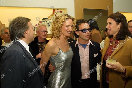 Stock Image of 03/15/01 (L-R)Diego Della Valle, Kelly Lynch, Emanuele Della Valle and Mimi Rogers at TOD'S Boutique in Beverly Hills. Mr. Diego Della Valle, Owner of the international luxury brand TOD's will be in Los Angeles to host the celebration in honor of the opening of the newly expanded TOD'S Boutique. A private dinner and after party will take place at Moomba Los Angeles. Photo®Alex Berliner/BEI