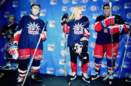 20010107 Madison Square Garden New York City Photo®Keri-Ann Laurito/BEI beiKAL0108-003 On Left Rick Moranis Center Super Model Kim Alexis On Right Howard Stern's Gary Dell'Abate Playing Hockey for the Superskate 2001 Charity Hockey Event