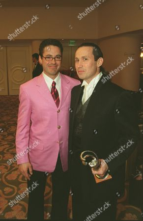 3-17-01 Robert Downey Jr. and Jeffrey Kurland (winner for Excellence in  Costume Design-Film Period/Fantasy and Contemporary) The 3rd Annual Costume Designers Guild Awards held at the Beverly Hills Hotel Crystal Ballroom in Los Angeles. Photo®BerlinerStudio/BEI B001211-25a