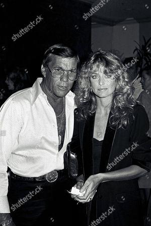 Director Hal Needham and Farrah Fawcett
