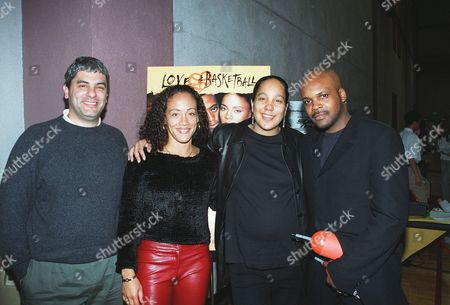 """20001013      Los Angeles, US Matt Lasorsa (Sr. VP Marketing at New Line Home Video), Erika Ringor (Cast), Gina Prince-Bythewood (Director),  and Reggie Bythewood at New Line Home Video's release of """"Love and Basketball"""" on VHS and DVD.  The event was held at USC-Lyon Center.  Laurie Wierzbicki/Berliner Studio/BEI A010336-07"""