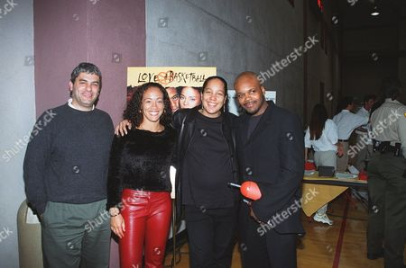"""Stock Image of 20001013      Los Angeles, US Matt Lasorsa (Sr. VP Marketing at New Line Home Video), Erika Ringor (Cast), Gina Prince-Bythewood (Director),  and Reggie Bythewood at New Line Home Video's release of """"Love and Basketball"""" on VHS and DVD.  The event was held at USC-Lyon Center.  Laurie Wierzbicki/Berliner Studio/BEI A010336-04"""