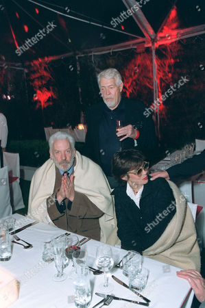 Stock Image of Donald Sutherland, Francine Racette and James Coburn