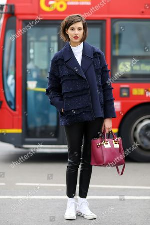 Editorial picture of Street Style, Spring Summer 2016, London Fashion Week, Britain - 21 Sep 2015
