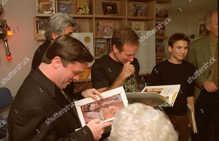 Nathan Lane, Robin Williams and Jonathan Taylor Thomas
