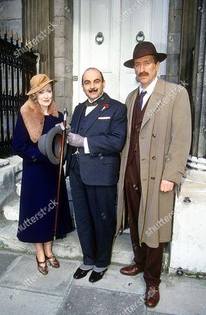 David Suchet, Pauline Moran (Miss Lemon) and Philip Jackson (Inspector Japp) in 'Poirot - Hickory Dickory Dock' - 1995