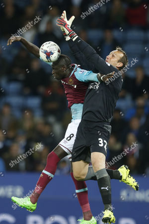 Mark Schwarzer of Leicester City is challenged by Cheikhou Kouyate of West Ham United