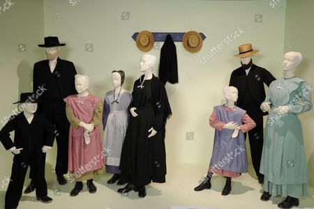 Stock Photo of 'Amish Grace' - (L to R)  Costumes/Actors: Amish Boy; David Curtis as Amish Elder, Amish Girl; Amish Teen, Kimberly Williams-Paisley as Ida Graber, Karley Scott Collins as Katie Graber, Matt Letscher as Gideon Graber and Kimberly Williams-Paisley as Ida Graber.