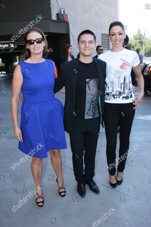 Stock Picture of Lisa Love, fashion designer Marc Blaskovits and a model wearing a Fashion Night Out T-shirt
