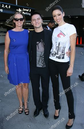 Stock Image of Lisa Love, fashion designer, Marc Blaskovits and a model wearing Fashion Night Out T-shirt