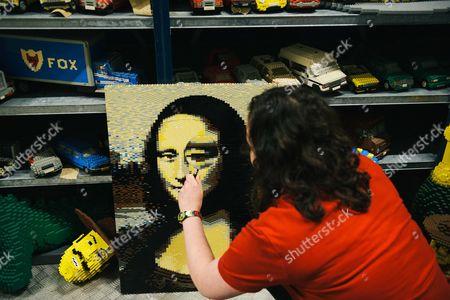 Amanda Green assesses the condition of a LEGO Mona Lisa