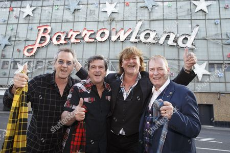 Stuart Wood, Les McKeown, promoter Donald MacLeod and Alan Longmuir outside the Glasgow Barrowlands