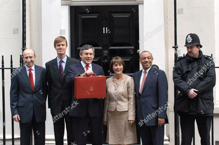Gordon Brown with the budget box and Paul Boateng (R)
