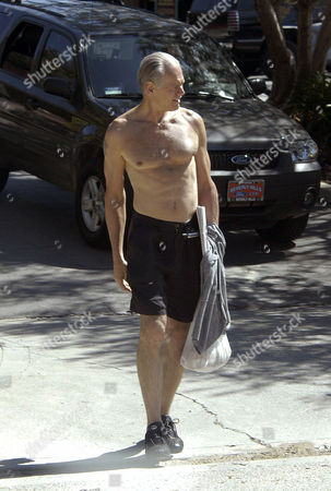 Fred Dryer, 58 years old, is looking fit. The 6 foot 6 inch tall Dryer surprised a few neighbors by walking around Bel Air's market topless after his morning run around Beverly Hills