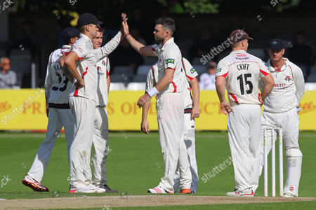 James Anderson (C) of Lancashire is congratulated by his team mates after taking the wicket of  Graham Napier during Essex CCC vs Lancashire CCC, Day Three