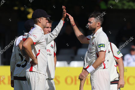 James Anderson of Lancashire (R) is congratulated by his team mates after taking the wicket of Graham Napier during Essex CCC vs Lancashire CCC, Day Three